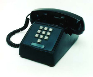 A push-button TouchTone phone from 1963. Note the * and # keys are not included, as they were not introduced until 1968.